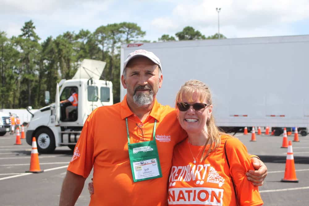 Jeff Falzon with a Reinhart supporter at IFDA truck driving championship.