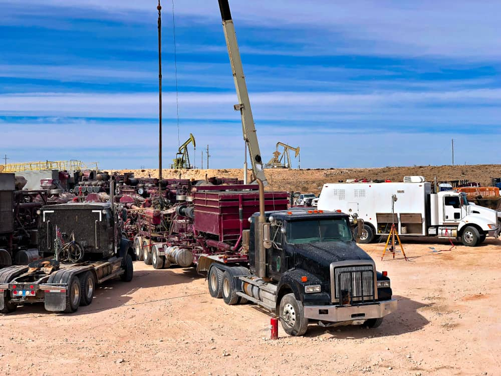 In the middle of the hot Permian oil and gas play, a trucking company is closing some operations